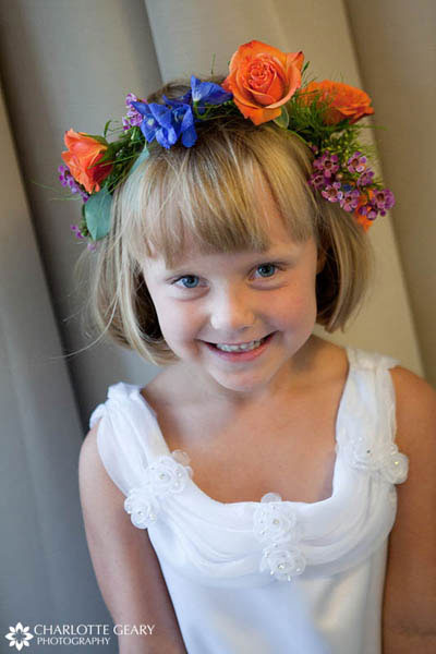 Flower girl with blue and orange garland