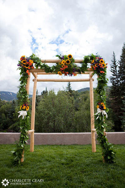 Altar garland of sunflowers and greenery