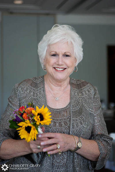 Mother of the groom with sunflower bouquet
