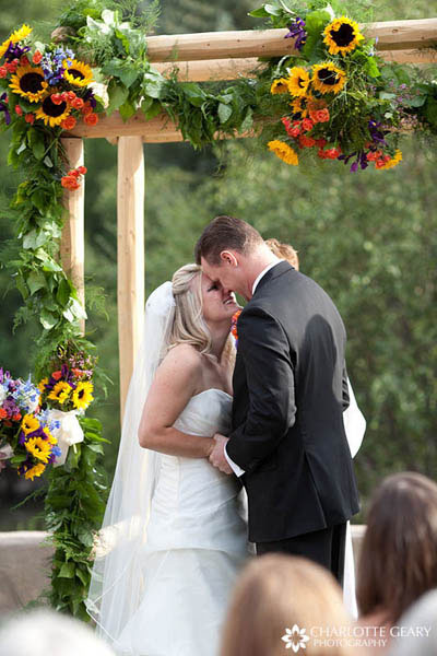 Ceremony arch decorated with sunflowers