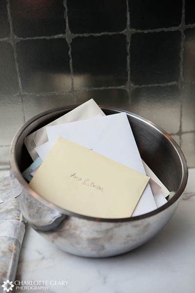 Wedding cards collected in a silver bowl