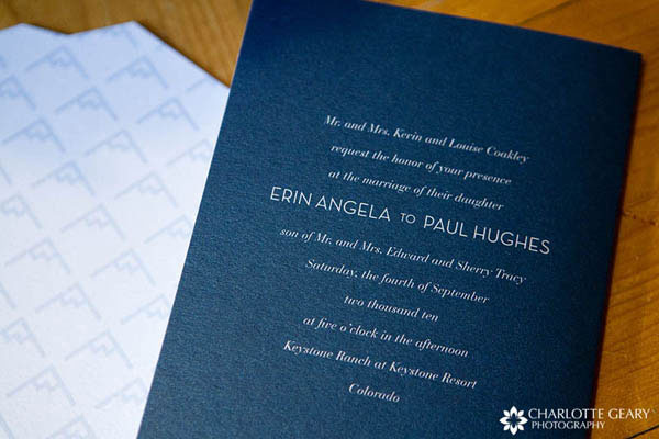 Blue wedding invitation with mountain graphics