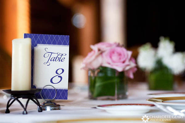 Round wedding cake with mountain theme Royal blue table numbers