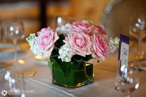 Pink rose centerpieces in square vases