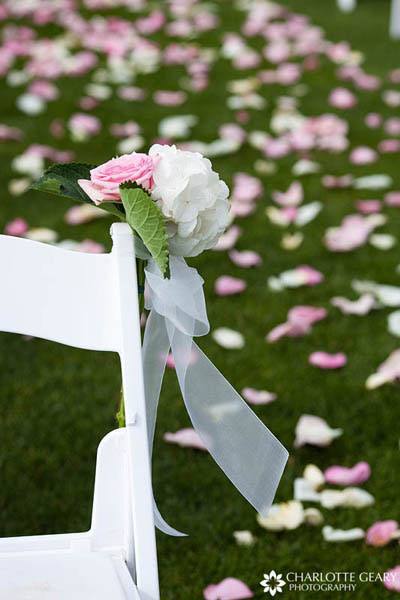 Pink and white ceremony decorations