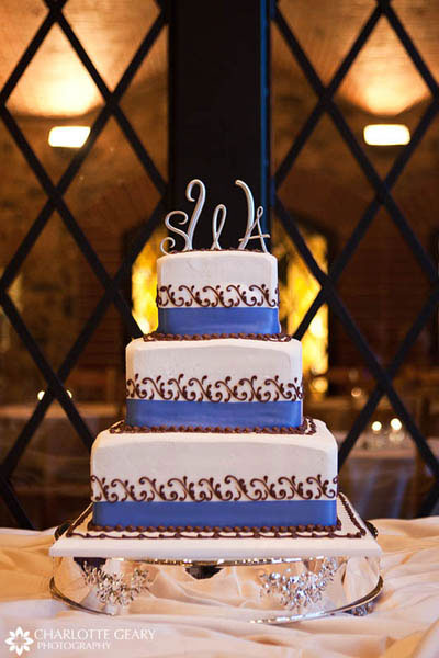Blue and brown square wedding cake with monogram cake topper