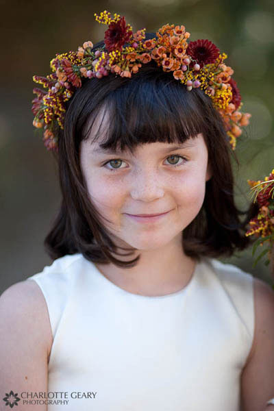 Flower girl with autumn floral garland