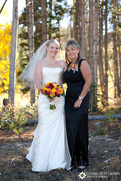 Mother of the bride in black dress with half-up hairstyle