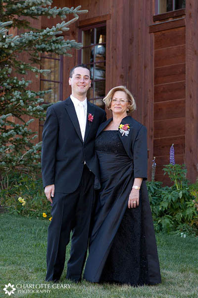 Mother of the groom in black dress and jacket