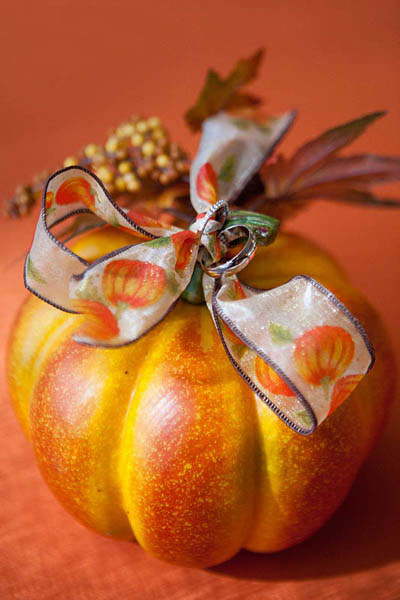 Wedding rings tied to a pumpkin as a ring pillow alternative