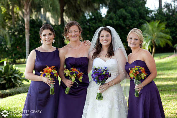 Bridesmaids in purple dresses with autumn flowers