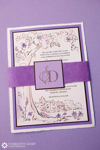 Purple wedding invitation with an illustration of the wedding venue