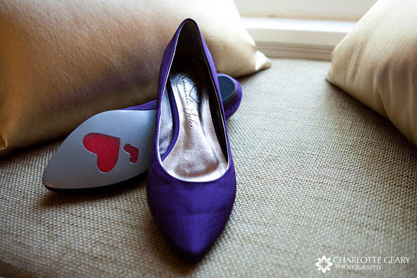 Purple wedding shoes with hearts on the soles