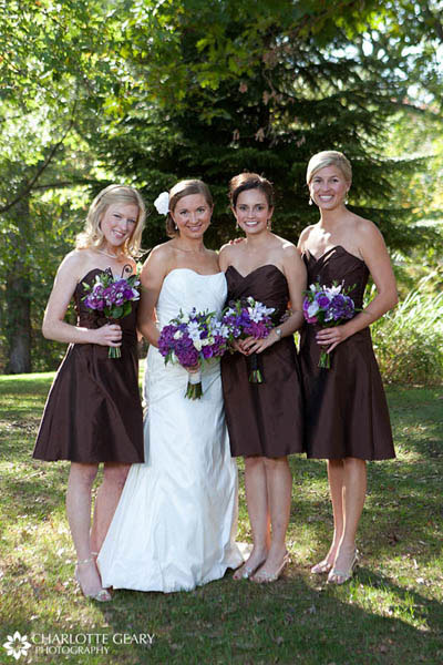 Bridesmaids in brown strapless dresses with purple flowers