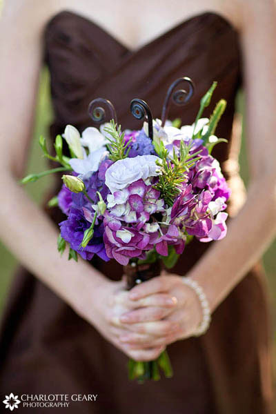 Bridesmaid with brown dress and purple bouquet