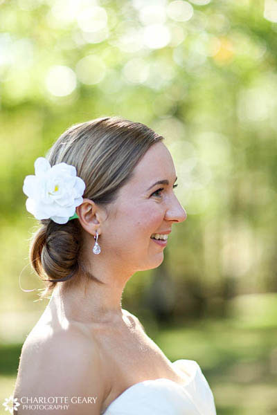 Bride with chignon and white flower in her hair
