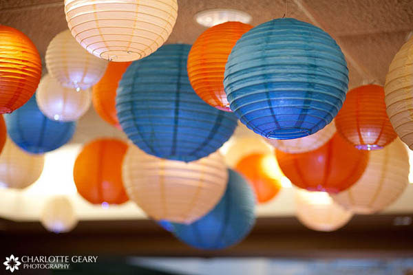 Blue and orange lanterns as wedding decorations