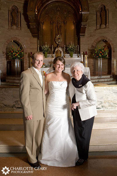 Grandmother of the bride in black and white suit