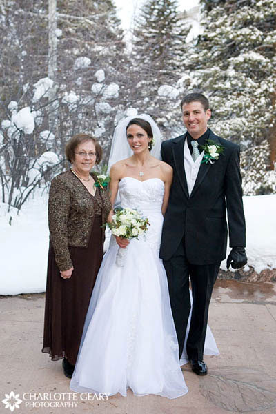 Mother of the bride in brown dress and jacket