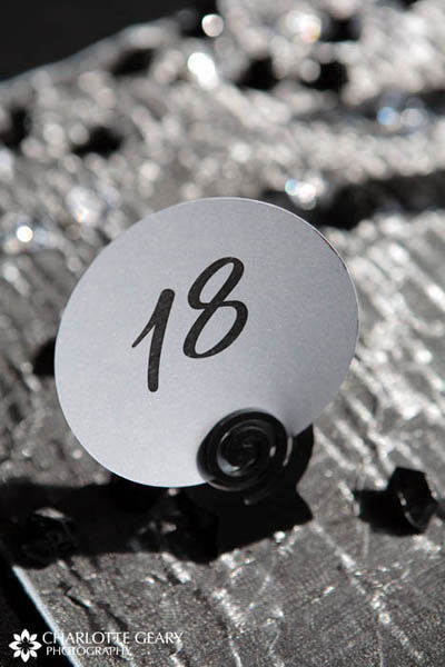 Round silver and black table number sign