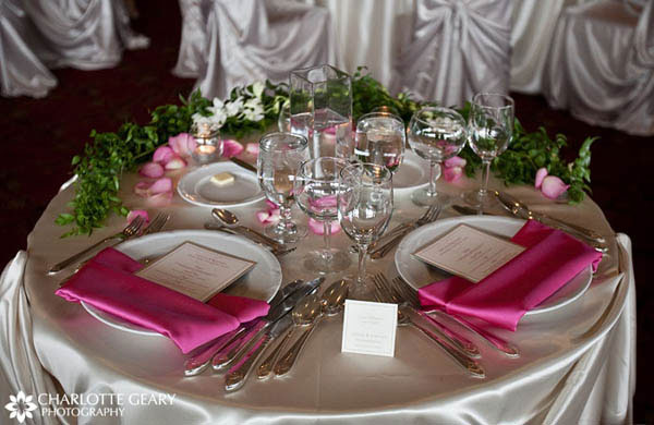 Pink and green table setting with menu cards