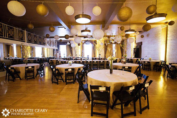 The Oxford Hotel in Denver, decorated with yellow lanterns and yellow uplighting