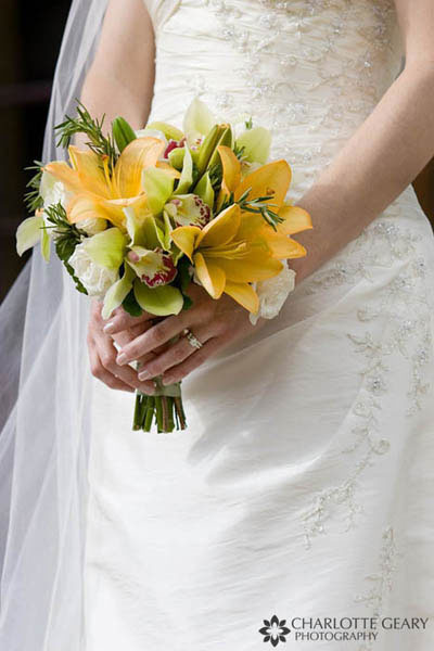 Yellow bouquet of lilies and orchids