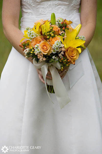Orange and purple bridal bouquet with mango calla lilies Bouquet of yellow