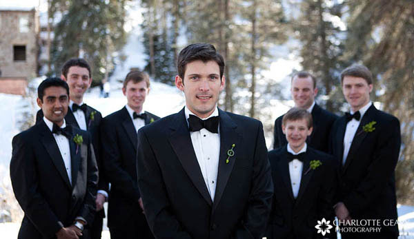 Groomsmen In Black Suits With Red Boutonnieres Tuxedos